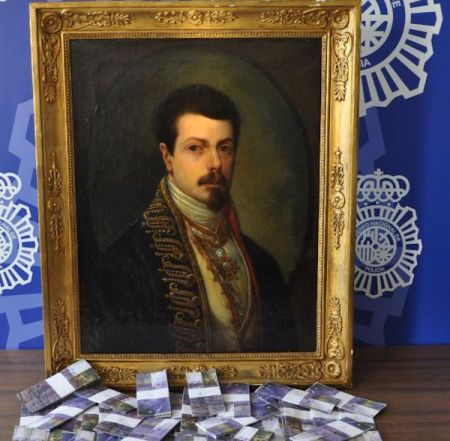 The fake Goya and fake money seized by Spanish Police Photo via: El País